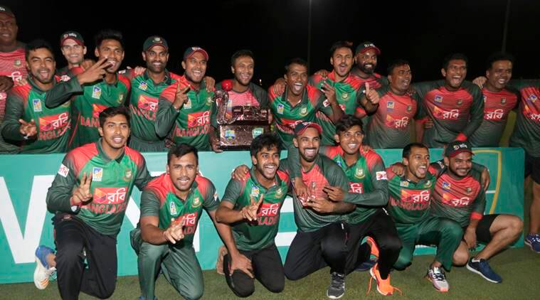 Players of the Bangladesh team pose with the trophy after Bangladesh defeated the West Indies in a Twenty20 international cricket match