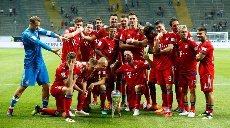 Bayern Munich players celebrate winning the German Super Cup with the trophy