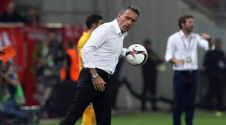 In this Sept. 29, 2016 file photo, then Olympiakos' coach Paulo Bento holds the ball during the Europa League Group B soccer match between Olympiakos and APOEL at Georgios Karaiskakis stadium in Piraeus port, near Athens