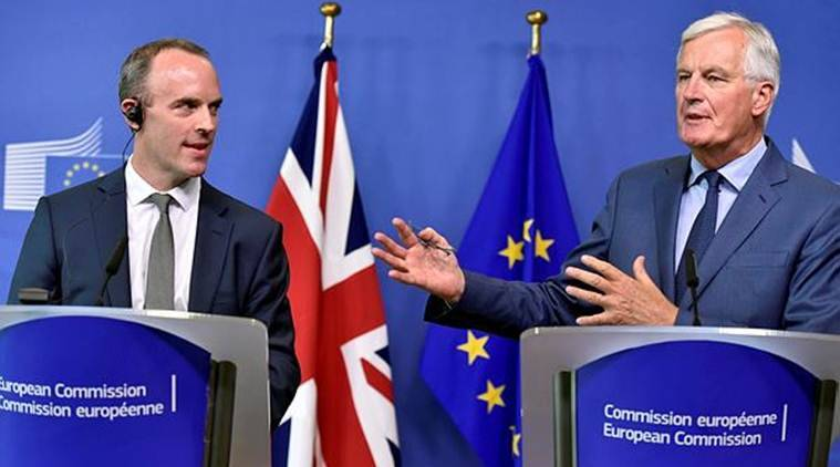 Britain's Secretary of State for Exiting the European Union, Dominic Raab and European Union's chief Brexit negotiator, Michel Barnier, brief the media after a meeting at the EU Commission headquarters in Brussels on Friday. (Reuters)