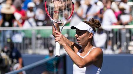 Mihaela Buzarnescu, of Romania, gestures to the crowd after defeating Elise Mertens, of Belgium, during the semifinals of the Mubadala Silicon Valley Classic tennis tournament in San Jose, Califonia