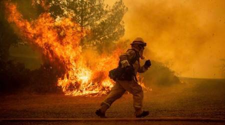 California's largest wildfire surges as temperature rises