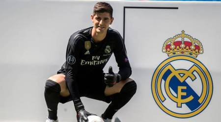 Real Madrid soccer player Thibaut Courtois poses for the media during his official presentation for Real Madrid at the Santiago Bernabeu stadium in Madrid