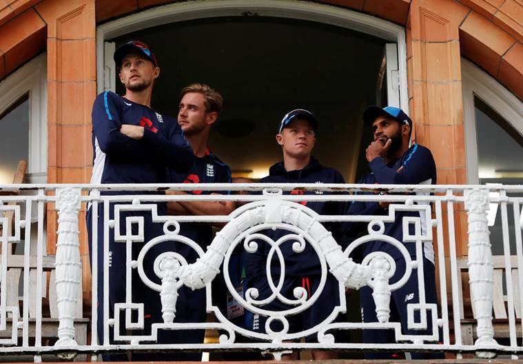England's Joe Root, Stuart Broad, Adil Rashid and Ollie Pope on the players balcony during a rain delay.
