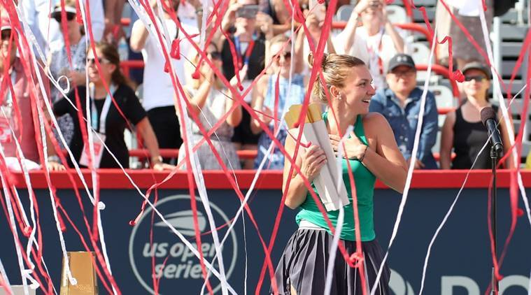 Confetti falls on Simona Halep of Romania as she win against Sloane Stephens of the United States (not pictured) during the Rogers Cup tennis tournament at Stade IGA.