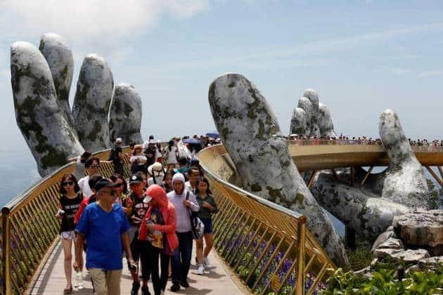 In the hands of the gods: Vietnam's Golden Bridge has giant support