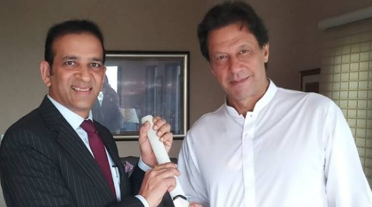 Imran Khan (R) presented with a bat by Indian High Commissioner to Pakistan Ajay Bisaria. (Source: ANI)