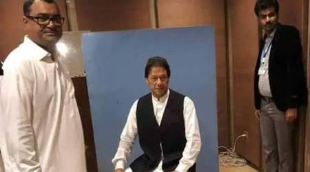 Imran Khan borrows waistcoat from National Assembly employee for official photo