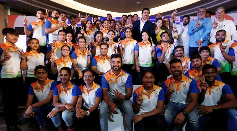 Members of India's Asian Games contingent with Sports Minister Rajyavardhan Singh Rathore.