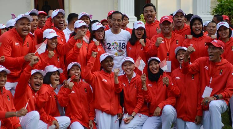 Indonesian President Joko Widodo (C) poses with Indonesian Asian Games athletes and officials at the presidential palace in Jakarta, Indonesia