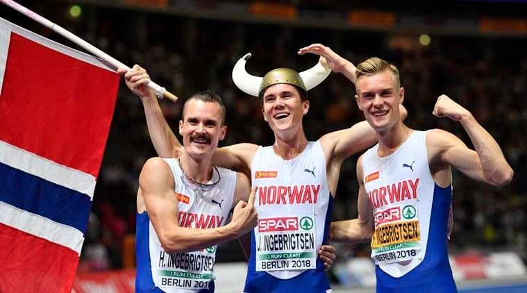 Norway's gold medal winner Jakob Ingebrigtsen is flanked by his brothers Henrik Ingebrigtsen, left, and Filip Ingebrigtsen after the men's 1500-meter final at the European Athletics Championships at the Olympic stadium in Berlin, Germany