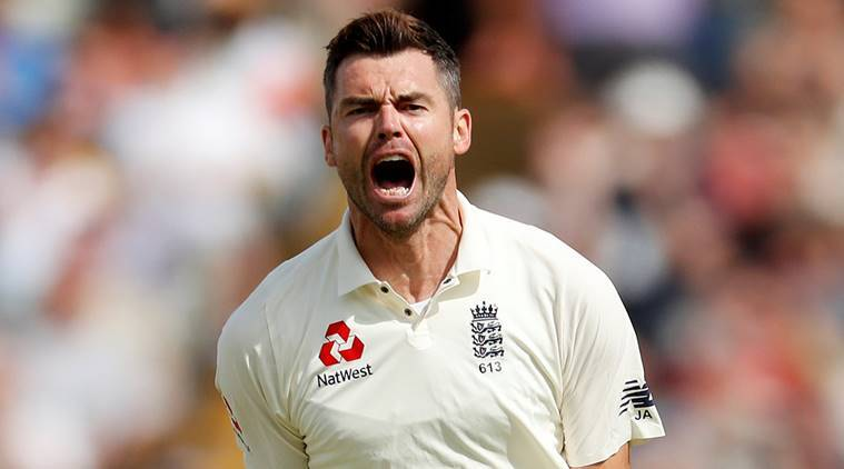 England's James Anderson celebrates the wicket of India's Dinesh Karthik
