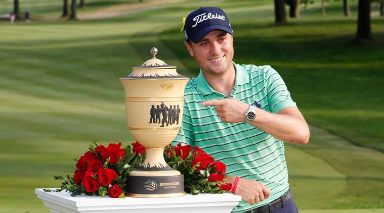 PGA golfer Justin Thomas poses with the Gary Player Cup after winning the WGC - Bridgestone Invitational golf tournament at Firestone Country Club