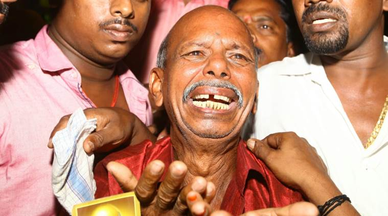 A DMK cadre breaks down outside Kauvery Hospital in Chennai on Monday. (Express photo)