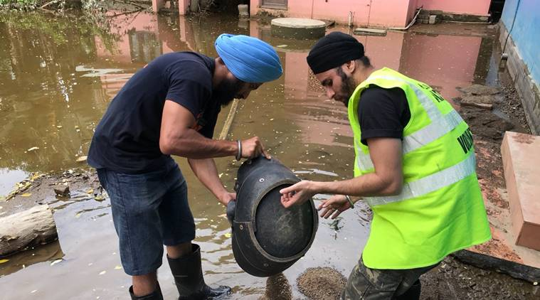 Khalsa Aid, Sikh Volunteers Khalsa aid, Kerala church, Sikh volunteers clean church, St Johns Marathoma church, Alleppey, Alleppey church, Kerala news, Kerala floods, Indian Express, latest news,