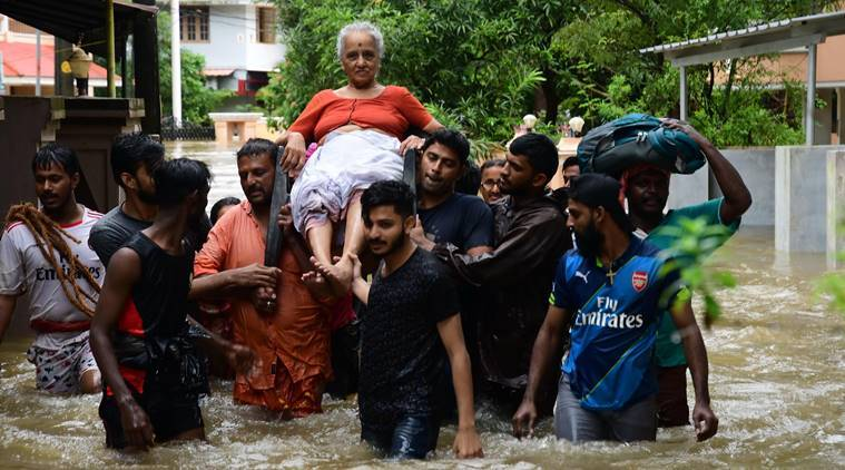 An elderly woman is rescued following a flash flood, triggered by heavy rains, at Palakkad in Kerala on Thursday. (PTI)