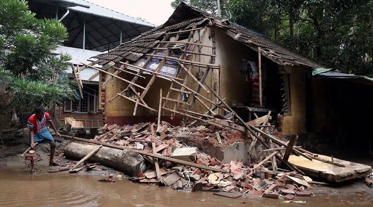 A man removes debris from a collapsed house