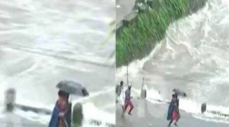 WATCH Video | Kerala rains: NDRF man runs across flooding bridge with child in arms