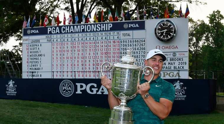 Brooks Koepka poses with the Wanamaker Trophy after winning the PGA Championship golf tournament at Bellerive Country Club.