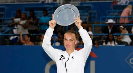 Svetlana Kuznetsova, of Russia, poses with the trophy after she defeated Donna Vekic, of Croatia, in the women's finals at the Citi Open tennis tournament