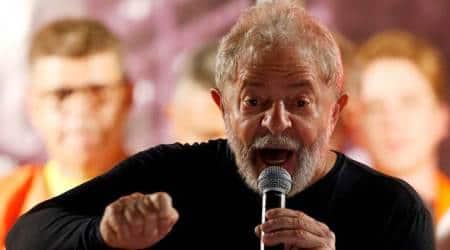 Former president Lula da Silva registers for Brazil elections from jail as thousandsrally
