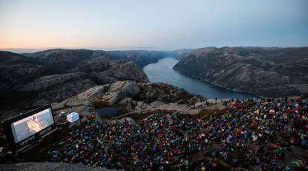Height of devotion: Fans scale 2,000 ft to watch Mission Impossible Fallout on top of a cliff!