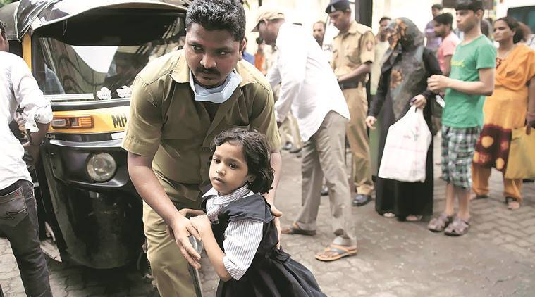 Mumbai school poisoning: Panic in Baiganwadi, police step in to control angry parents