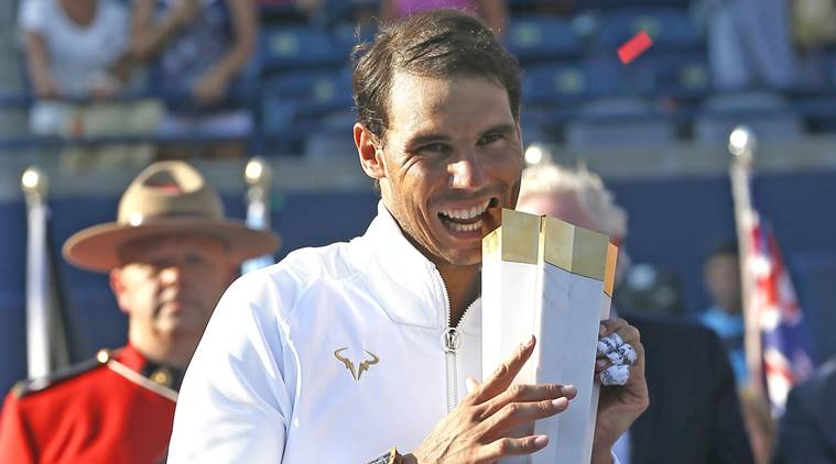 Rafael Nadal (ESP) poses with the Rogers Championship trophy in the Rogers Cup tennis tournament at Aviva Centre.
