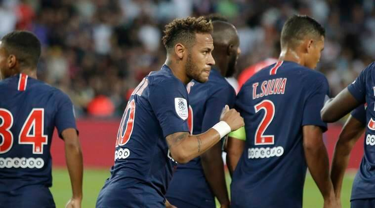 PSG's Neymar, center, celebrates the opening goal during their League One soccer match between Paris Saint-Germain and Caen at Parc des Princes stadium in Paris