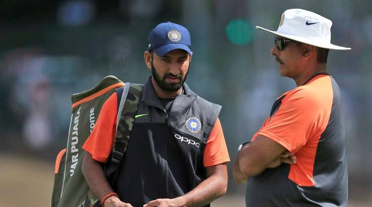 India's Cheteshwar Pujara left and head coach Ravi Shastri talk during a nets session at Edgbaston a day ahead of the 1st test cricket match between England and India