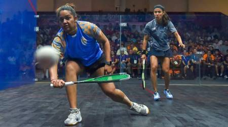 India's Deepika Pallikal and Ann Nicol David of Malaysia in action during the women's squash semifinal match at 18th Asian Games 2018.