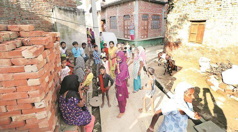 Mostly women and children were seen in kuderkot village on Thursday. (Express photo/Vishal Srivastav)