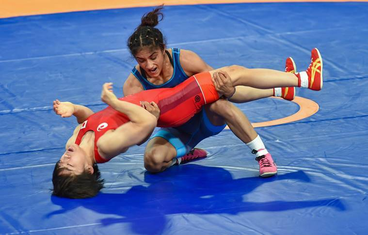 India's Vinesh Phogat (blue) in action against Japan's Yuki Irie during the final bout of women's freestyle 50 kg wrestling event, at the Asian Games 2018, in Jakarta