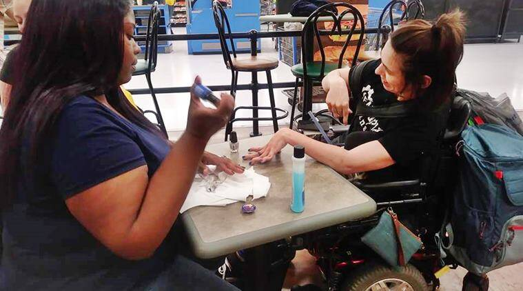 walmart, cashier helps cerebral palsy woman, cerebral palsy woman denied nail salon, cashier manicures cerebral palsy woman, good news, viral news, indian express