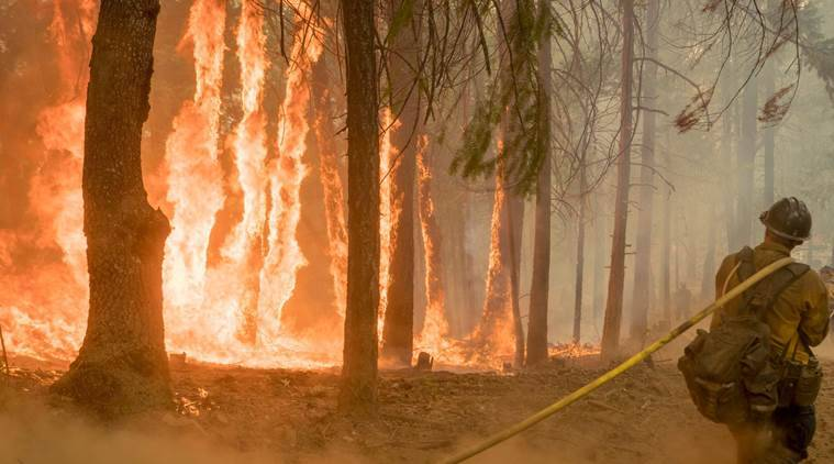 More than 100 large wildfires in US as new blazes erupt