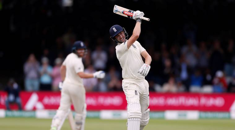 England's Chris Woakes celebrates reaching a century against India at Lord's in second Test