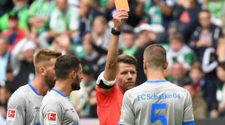 Bundesliga Roundup: VAR takes center stage as Wolfsburg upset 10-man Schalke