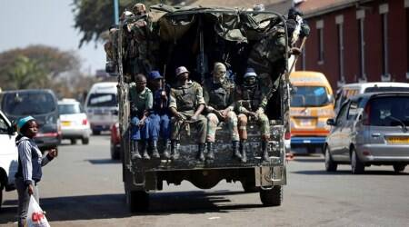 Troops clear streets of Zimbabwe's capital, election result 'very soon'
