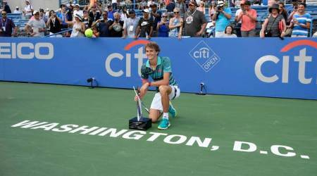 Alexander Zverev poses with the trophy after he defeated Alex de Minaur in the men's finals in the Citi Open tennis tournament
