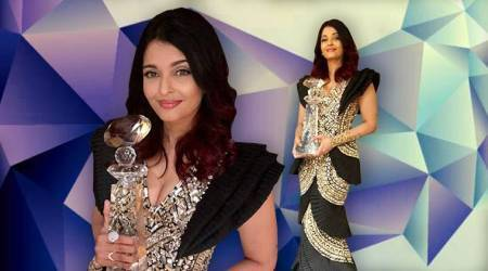 Aishwarya Rai Bachchan donned a blingy fishtail gown to collect her Meryl Streep Award for Excellence