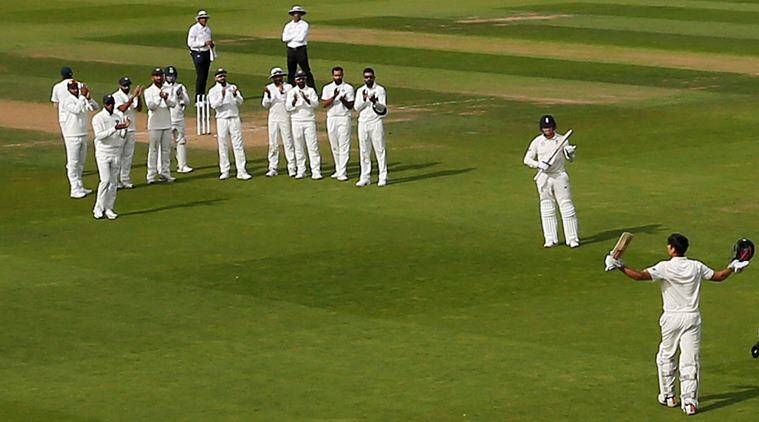 England's Alastair Cook reacts as Jonny Bairstow, India players and fans applaud him as he walks off after losing his wicket