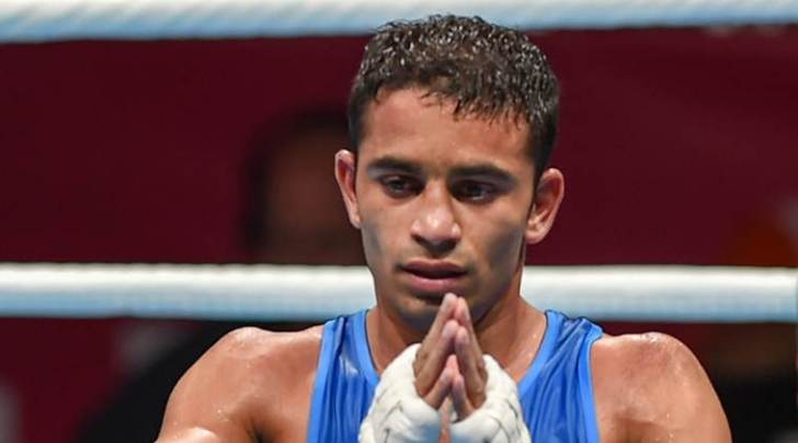 India's Amit Panghal gestures after he was declared winner against Paalam Carlo (unseen) of Philippines in the Men's Light Fly (46-49kg) boxing semifinal bout at the 18th Asian Games 2018 in Jakarta, Indonesia