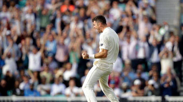 England's Jimmy Anderson celebrates taking the wicket of India's Cheteshwar Pujara to equal the most number of wickets taken by a pace bowler during the fifth cricket test match of a five match series between England and India at the Oval cricket ground