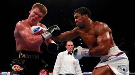 Anthony Joshua knocks out Alexander Povetkin to retain heavyweighttitles