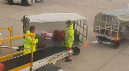 Ryanair passenger records baggage handler tossing luggage at Manchester airport