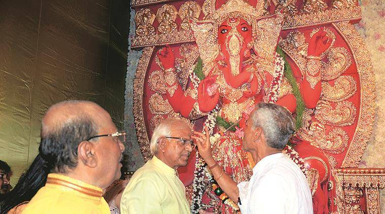 Ministers Sadhan Pande (left) and Sovandeb Chattopadhyay during Ganesh puja at Pande's home. (Express photo)