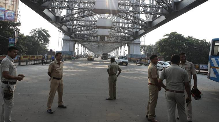 A strong contingent of police was deployed on the Howrah Bridge and in several other areas. (Express photo/Partha Paul)