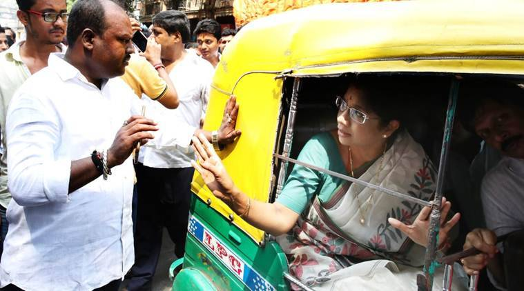 Bengal minister Shashi Panja in an auto at a TMC rally in Burrabazar area in Kolkata. (Express photo/Partha Paul)