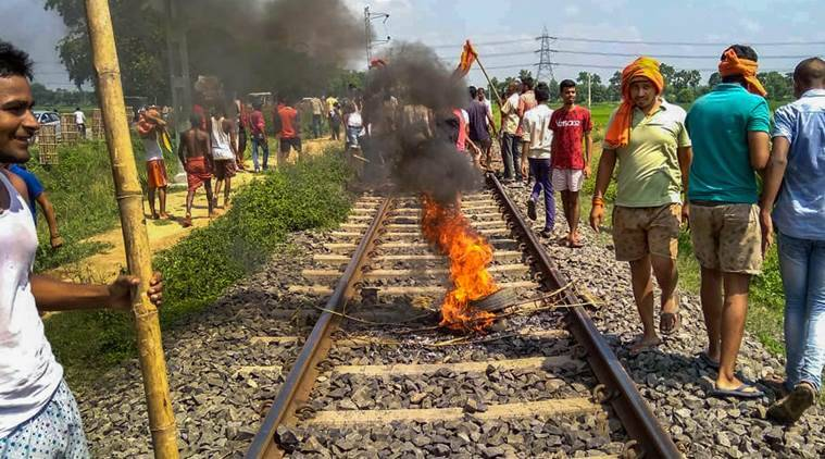 Swarn Sena activist burn tyres on the railway tracks to stop trains during their Bharat bandh, called to press for reservation, in Patna, Thursday, Sept 6, 2018. (PTI Photo)