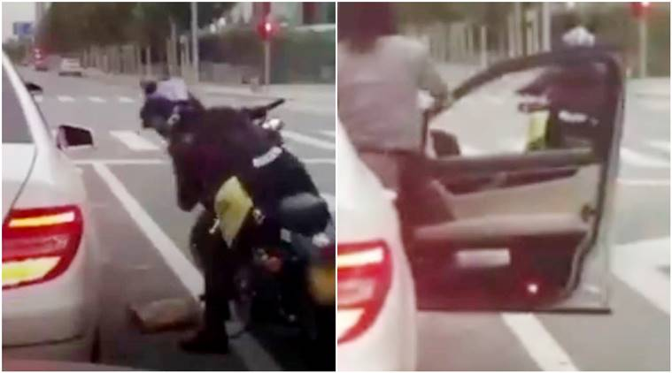 biker throws back trash in car, Beijing, motorcyclist picked garbage bag thrown by driver, china,